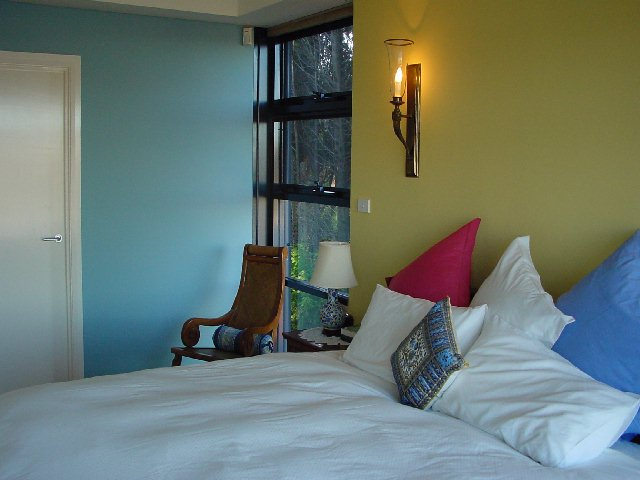 warm yellow with blue bedroom